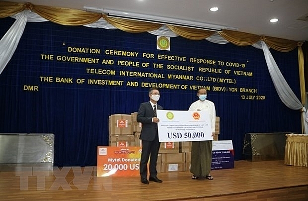 vietnam hands over usd 50000 supporting myanmars covid 19 fight