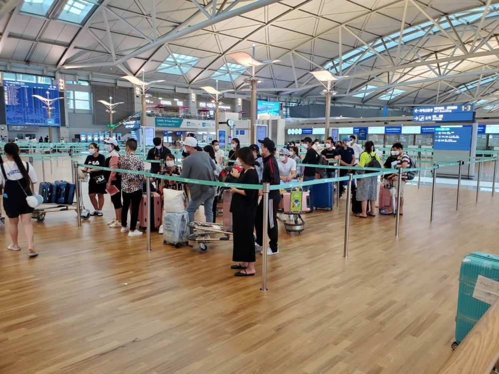 another flight carries citizens home from canada rok local spread widens
