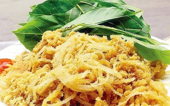 A Delicacy of Hanoi: Nem Phung (Fermented Pork) With Cluster Fig Leaves