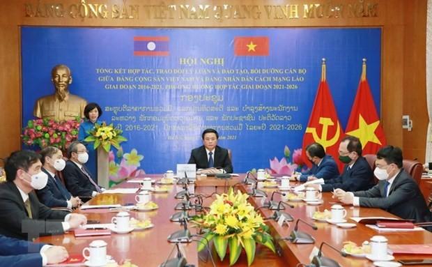 Vietnamese, Lao Parties Boost Cooperation in Theoretical Exchange