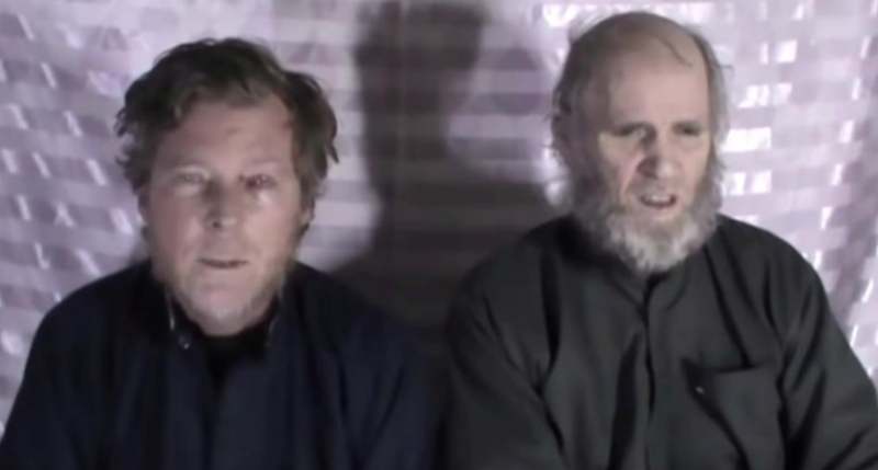 taliban frees two western prisoners