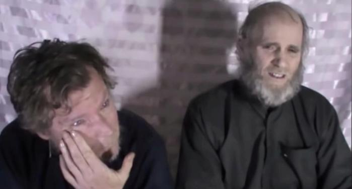 taliban frees two western prisoners