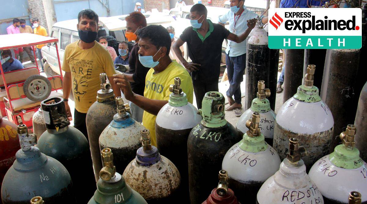 Customers at a store selling medical oxygen cylinders in Lucknow on Friday. (Express Photo: Vishal Srivastav)