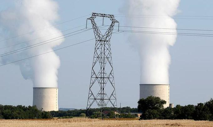 Cooling towers and high-tension electrical power lines are seen near the Golfech nuclear plant on the border of the Garonne River between Agen and Toulouse, France, August 29, 2019. Photo by Reuters/Regis Duvignau.