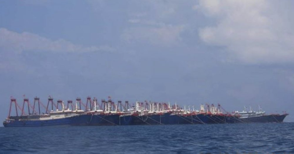 In this March 7, 2021, file photo provided by the Philippine Coast Guard/National Task Force-West Philippine Sea, some 220 Chinese vessels are seen moored at Whitsun Reef, South China Sea. The Philippine government has summoned the Chinese ambassador to press a demand for Chinese vessels to immediately leave the reef claimed by Manila in the disputed South China Sea and said the illegal presence was stoking regional tension, the Department of Foreign Affairs said Tuesday, April 13, 2021. (National Task Force-West Philippine Sea via AP, File)