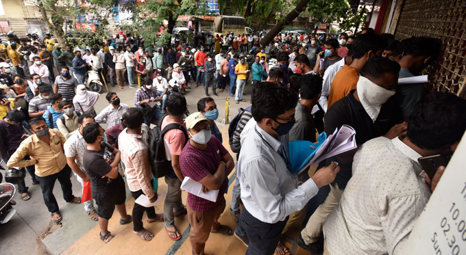 In early April, acute shortages of remdesivir in Pune hospitals resulted in long queues outside the Indian city's pharmacies. Health officials blamed indiscriminate use of the antiviral drug for shortages in Pune and elsewhere. AP IMAGES