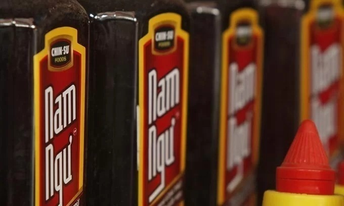 Masan Group's Nam Ngu brand fish sauce displayed for sale at a market in Hanoi. Photo by Reuters.