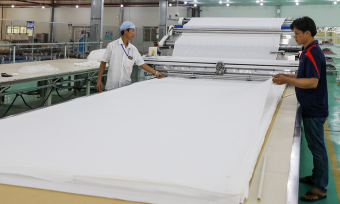Workers at a textile factory in Vietnam's southern province of Long An, February 2020. Textile is on the list of industries expected to benefit from the new free trade deal between Vietnam and the U.K. Photo by VnExpress/Quynh Tran.