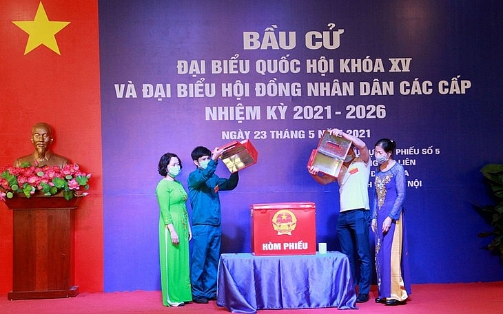 Ballot boxes are checked at a polling station in Hanoi's Kim Lien ward.