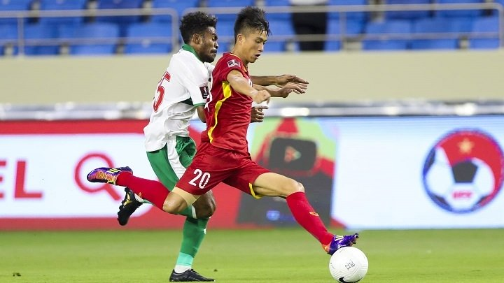 Vietnam's Phan Van Duc (in red) in action during their Group G match against Indonesia in the World Cup Asian qualifiers on June 7. (Photo: AFC)