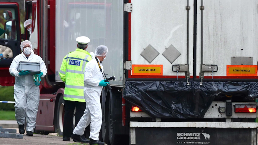 Police at the scene where bodies were discovered in the back of a truck in Essex.(Reuters