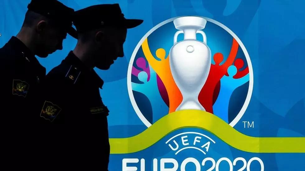 Police officers walking past a UEFA Euro 2020 in Saint Petersburg Olga MALTSEVA AFP/File