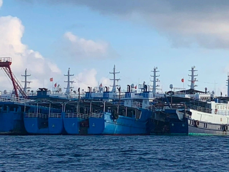 Chinese vessels, believed to be manned by Chinese maritime militia personnel, are seen in the Philippines' EEZ on March 27, 2021 [File: Philippine Coast Guard/National Task Force-West Philippine Sea/Handout via Reuters]