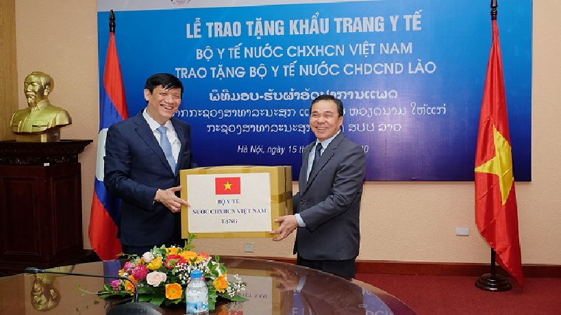 vietnam gifts laos 200000 face masks to aid covid 19 fight