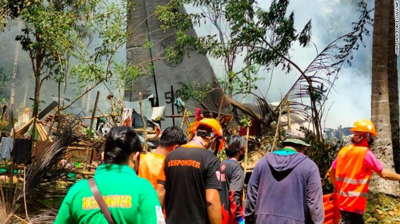 Rescuers search for bodies at the site where the plane crashed.