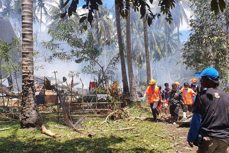 he C-130 crashed while attempting to land during the weekend. Authorities have recovered a black box from the scene [Joint Task Force-Sulu via AFP]