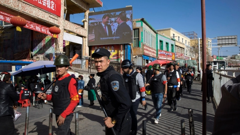 In 2019, the Trump administration also added some of China's top artificial intelligence startups to its economic blacklist over its treatment of Muslim minorities in Xinjiang, including widespread surveillance [File: Ng Han Guan/AP]