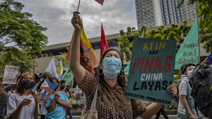 Filipinos march as they mark Independence day with a protest against continued Chinese intrusions in Philippine waters, outside the Chinese Embassy on June 12, 2021 in Makati, Metro Manila, Philippines. Ezra Acayan | Getty Images News | Getty Images