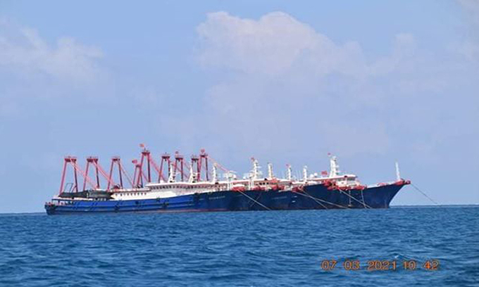 A Chinese military vessel is seen near the Whitsun Reef, March 7, 2021. Photo by Reuters.