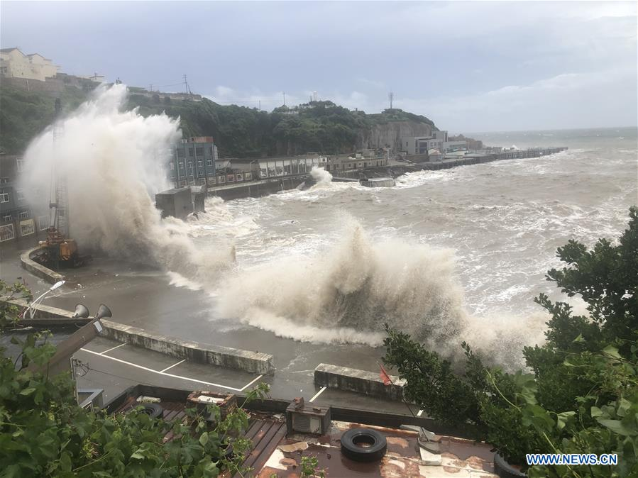 hagupit lashes eastern china with flooding rain strong winds as it creates rough seas
