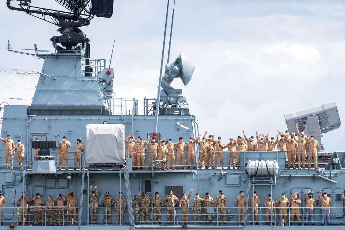 Crew members of the Bayern wave as the frigate sets sail on an exercise voyage lasting about six months in the Indian and Pacific Oceans. Photo: DPA