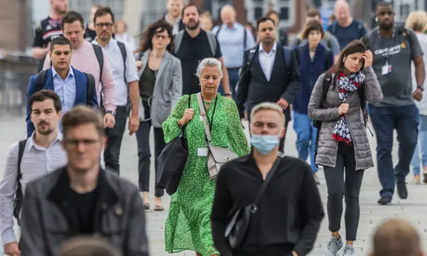 Commuters on London Bridge. Prof Sir Andrew Pollard, director of the Oxford Vaccine Group, said: 'The Delta variant will still infect people who have been vaccinated.' Photograph: Guy Bell/REX/Shutterstock