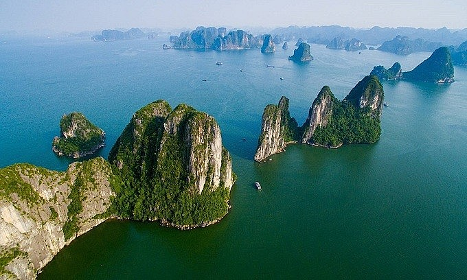 Limestone karst mountains rise out of the waters in Ha Long Bay, Quang Ninh Province. Photo by Shutterstock