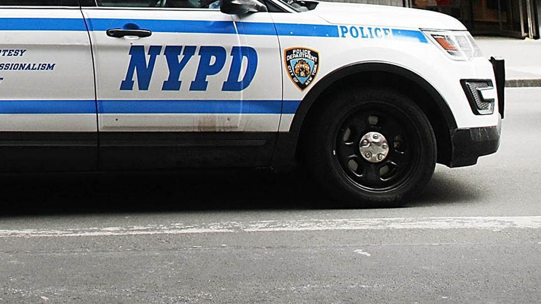 new york city police officer charged of acting as illegal agent china