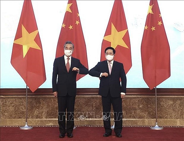 Politburo member and Standing Deputy Prime Minister Pham Binh Minh (R) and Chinese State Councilor and Foreign Minister Wang Yi  (Photo: VNA)