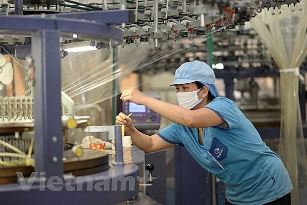usinesses are stepping up efforts to maintain production and weather difficulties caused by the COVID-19 pandemic (Photo: VietnamPlus)