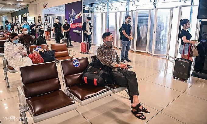 Passengers wait for boarding at Hanoi's Noi Bai International Airport, Oct. 10, 2021. Photo by VnExpress/Giang Huy