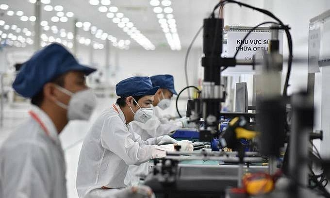 Employees work at a smartphone factory in Hai Phong City, northern Vietnam. Photo by VnExpress