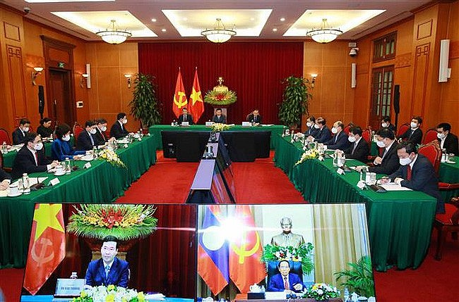 Vietnam, Laos Share Party Building Experience