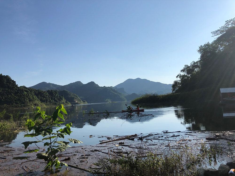 kayaking on mountains lake
