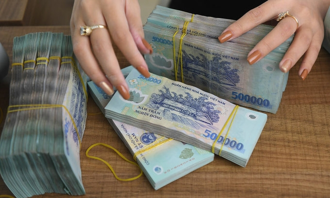 vietnam central bank reduces rates to aid post pandemic recovery