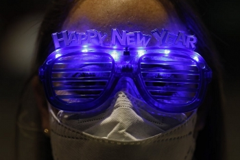 in photos new years eve around the world with pandemic controlling muting celebrations