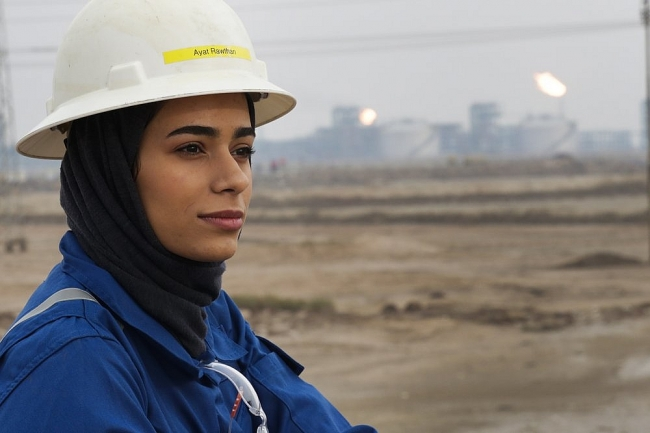 A few women take up grueling work at rig sites in oil-rich Iraq
