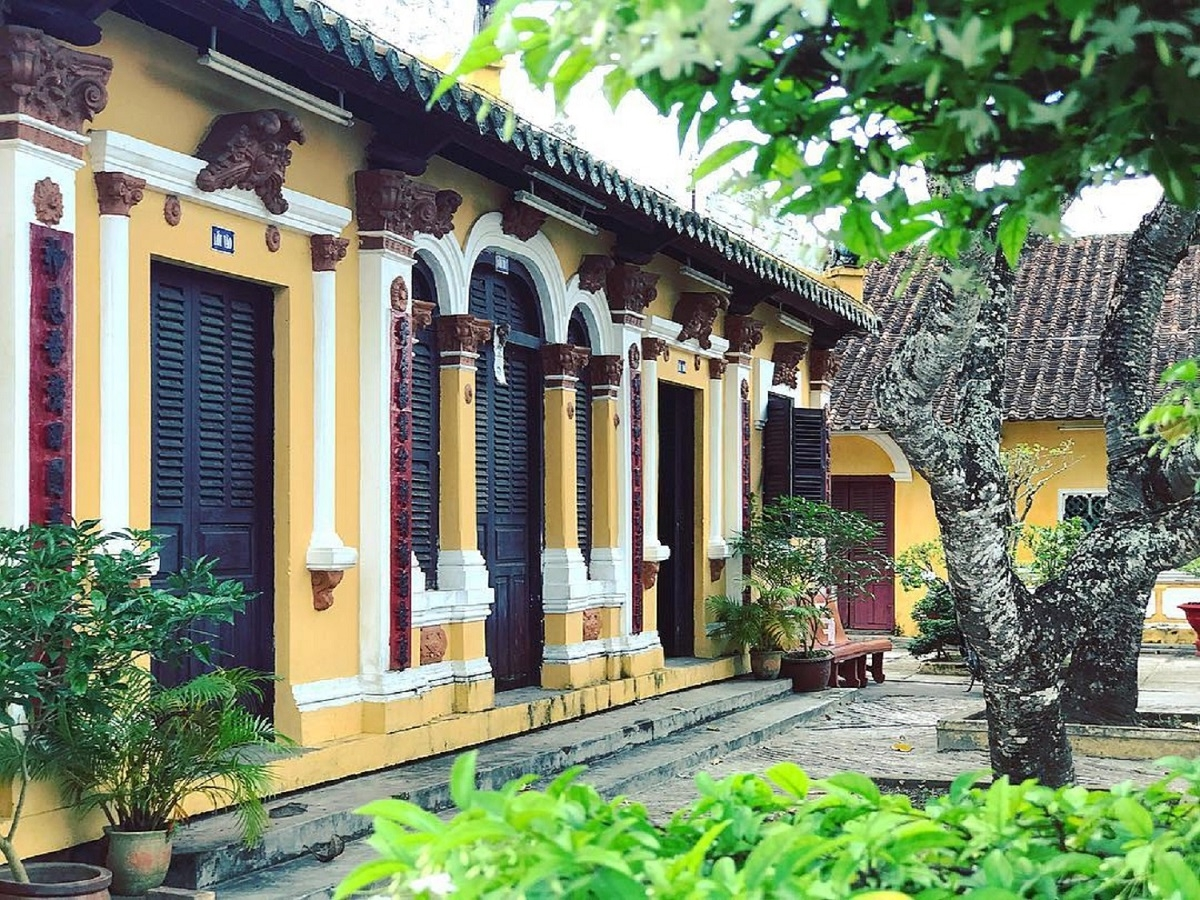 Admiring two-century-old communal house in Mekong Delta