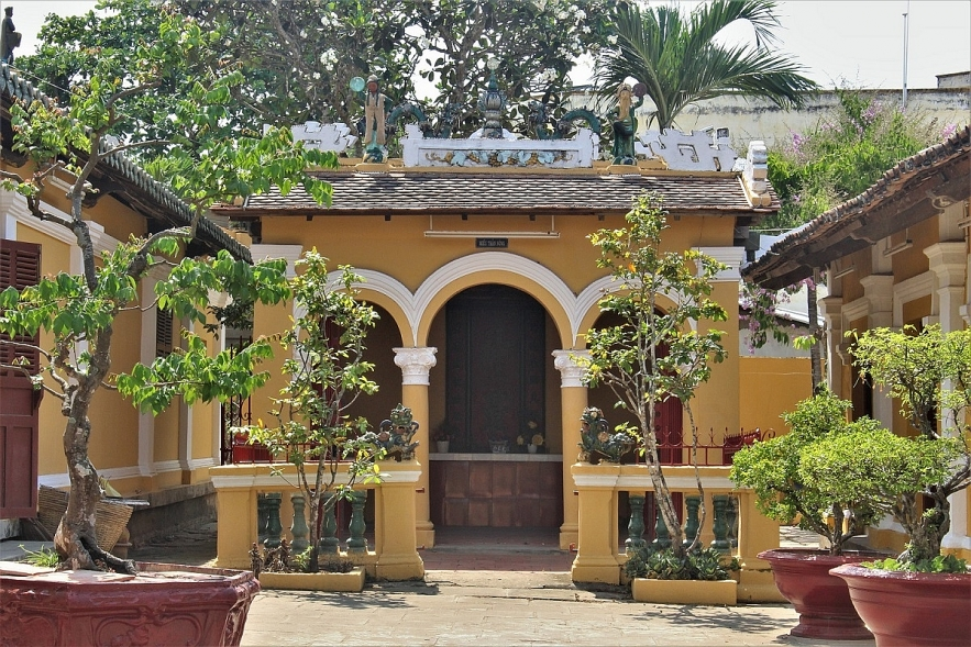 Admiring two century-old communal house in Mekong Delta