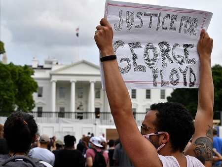 US News today: White House on lockdown, a police car be on fire over George Floyd death