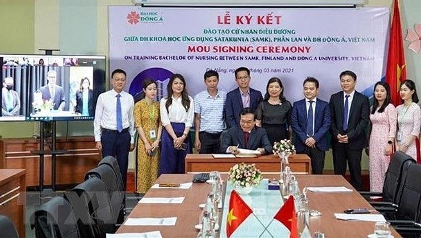 At a signing ceremony between Vietnamese and Finnish universities. Photo: VNA.