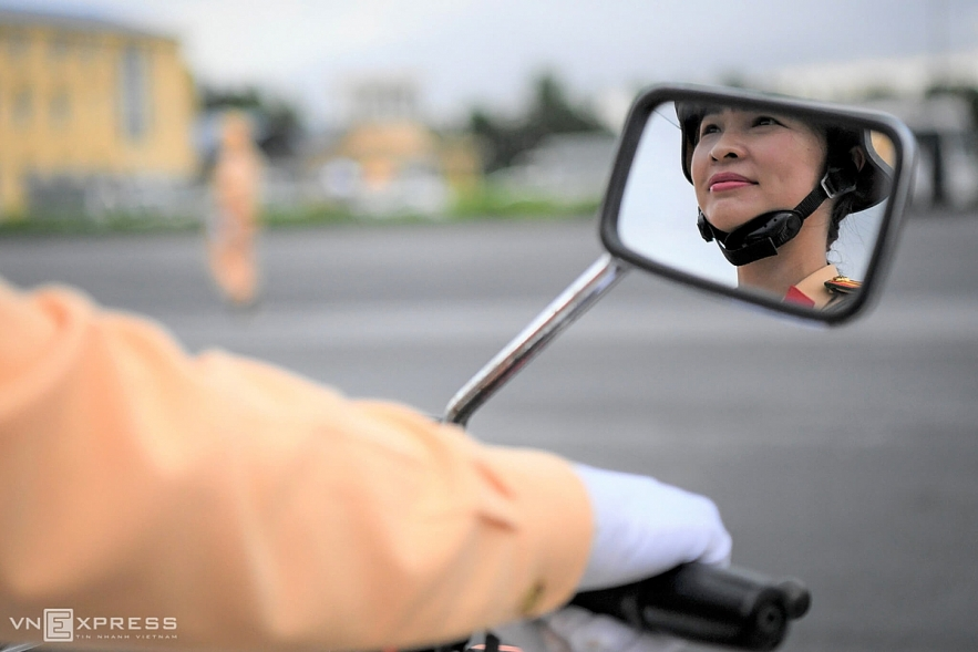 Vietnamese traffic police women exercise to lead groups of delegation by powerful motorcycles.