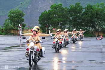 Vietnamese traffic policewomen exercise to lead groups of delegation by powerful motorcycles.