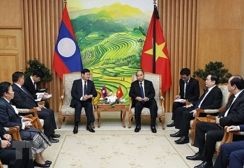 vietnamese and lao governments determine to foster comprehensive cooperation