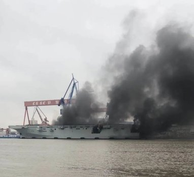 a new chinese amphibious assault ship caught fire