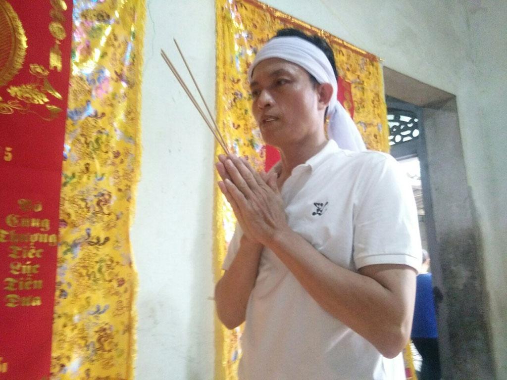 Mr. Tran Van Hai in front of his daughter's altar