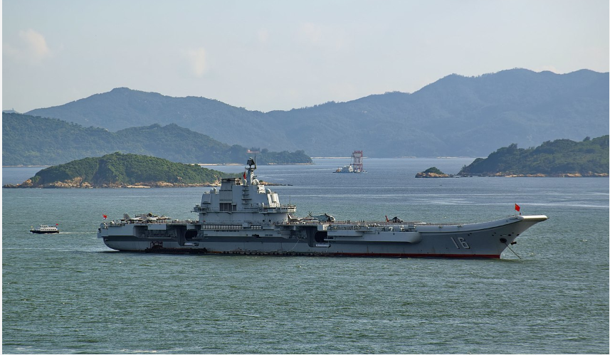 china deploys 2 aircraft carriers while the uss two air force b 1b lancer bombers flying over the east sea