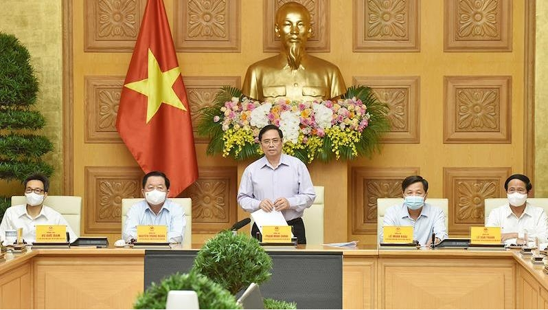 Prime Minister Pham Minh Chinh at a meeting with representatives from press agencies (Photo: