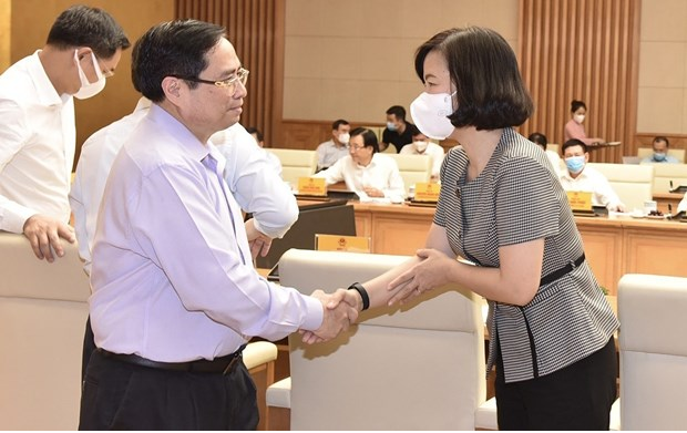 Prime Minister Pham Minh Chinh meets representatives from press agencies on the occasion of the 96th anniversary of Vietnam Revolutionary Press Day (June 21). (Photo: VNA)