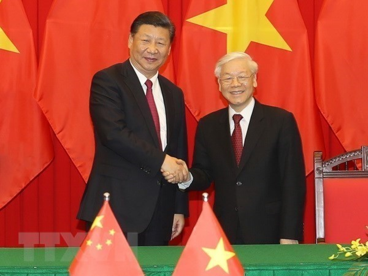 Vietnamese Party General Secretary and State President Nguyen Phu Trong (R) and his Chinese counterpart Xi Jinping during the former's visit to China in January 2017.(Photo: VNA)